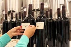 Hand Labeling Revana Family Vineyards