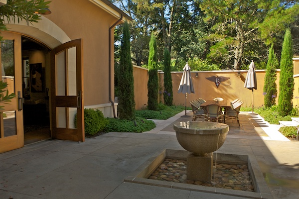 Enjoy the serene courtyard at Revana on your Napa Valley wine tour with Beau Wine Tours!