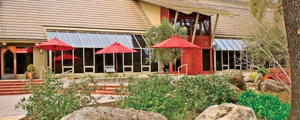 Relax with a glass at Rutherford Ranch on your Napa Valley group wine tour with Beau Wine Tours!